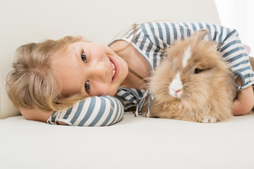 Little girl with bunny