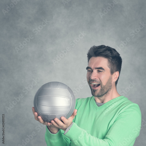 Man is happy about a Football