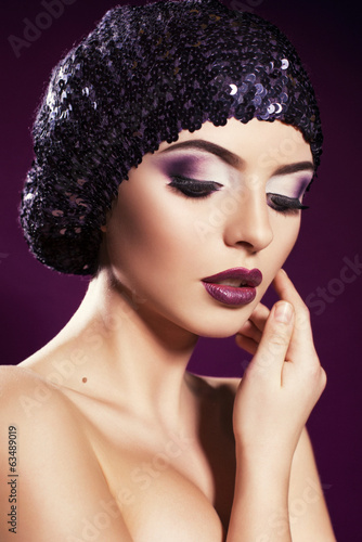 beautiful model with smokey eyes make up in hat