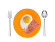 Scrambled eggs and roasted bacon with spices on orange plate wit