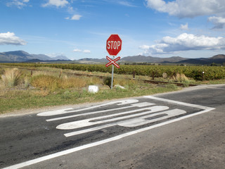 Stop sign at unmanned railway level crossing South Africa