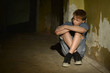 boy sitting in dark