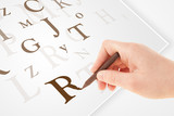 Hand writing various letters on white plain paper