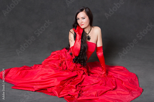 Latino Woman with long hair  in red