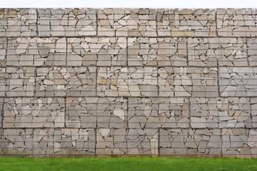 Hintergrund Mauer aus Gabionen