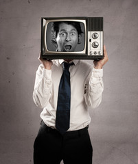 businessman holding old retro television