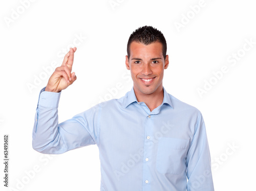 Attractive hispanic man with luck gesture