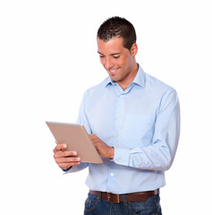 Charismatic guy working with his tablet pc