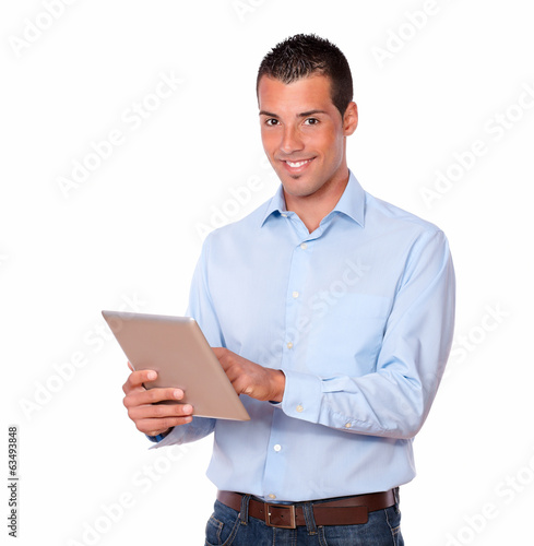 Latin man working with his tablet pc