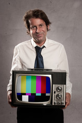 businessman holding old retro television