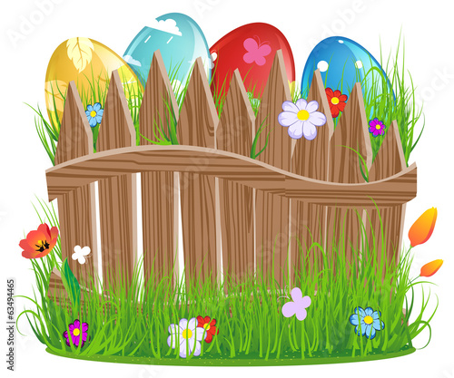 Easter eggs with grass and fence