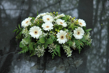 Funeral flowers on a tomb