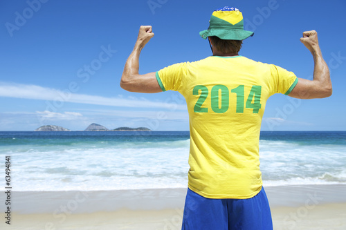 Brazilian in 2014 Football Shirt Celebrating on Rio Beach