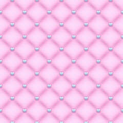 Seamless pink quilted background with silver heart shaped pins.