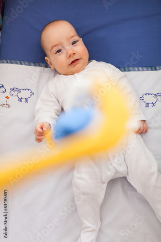 Baby looking at a toy