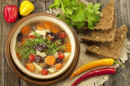 Bowl of bean soup with rye bread