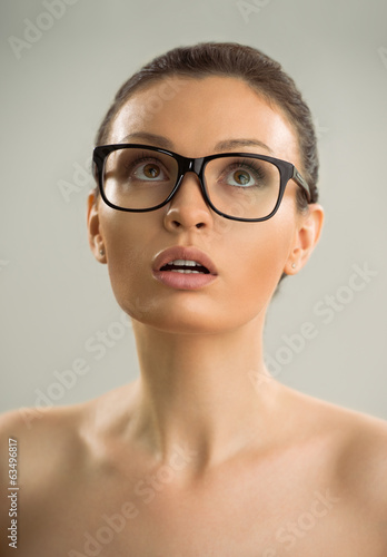 Portrait of hot sexy naked woman wearing glasses