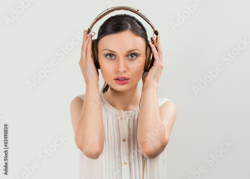 Woman with headphones listening music. Music teenager girl danci