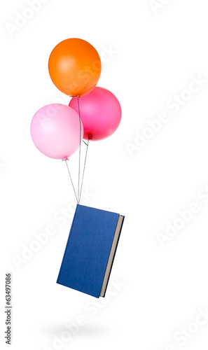 Light reading - book suspended by balloons.