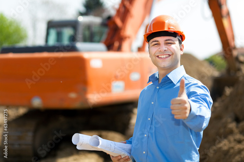Architect thumbs up in a construction site
