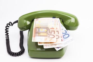 Grünes Telefon und Geldscheine