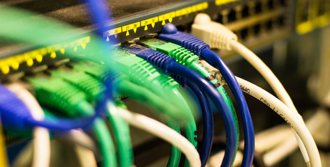 UTP Network cables connected to an Fast-Giga ethernet ports