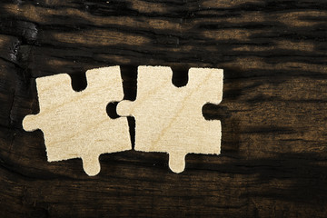 Wooden puzzle on dark background.