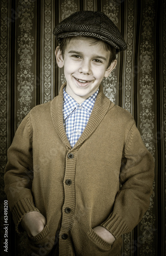 Smiling child in vintage clothes and hat