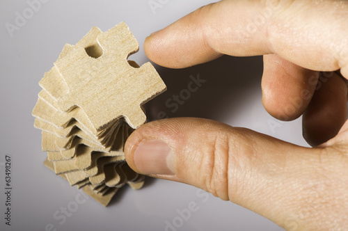 Wooden puzzle on white background.