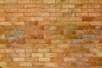 Bricks wall in orange with slightly different tones