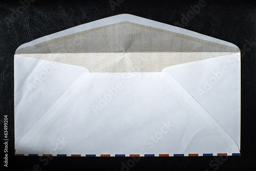 Open envelope on black background