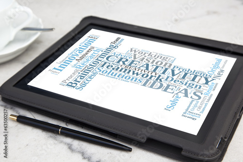tablet with creativity word cloud