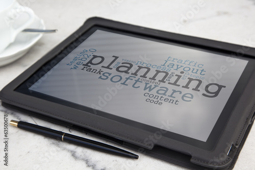 tablet with planning software word cloud