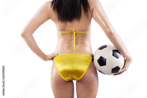 Backside sexy woman holding a soccer ball