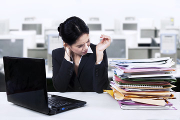 Businesswoman having a painful neck