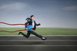 Businesswoman winning a business race