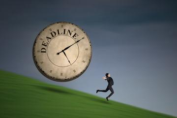 Businesswoman running with a deadline clock