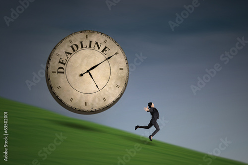 Businesswoman running with a deadline clock