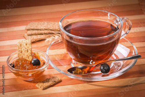 Black tea with cookies and apricot jam