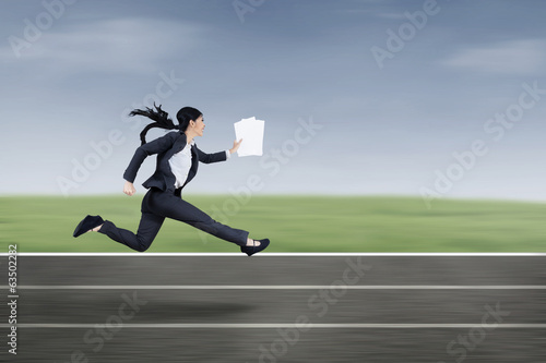 Busy businesswoman running fast outdoor