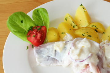 Soused herring with potatoes