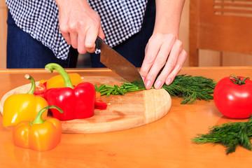 Woman prepares a salad