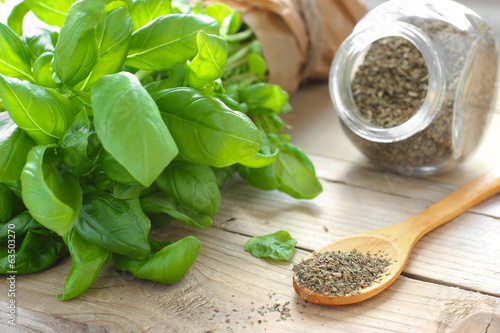 Fresh and dried basil in glass jar