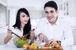 Couple making vegetables salad
