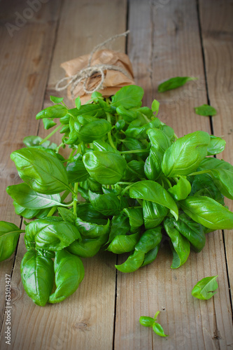 Fresh basil on wooden background