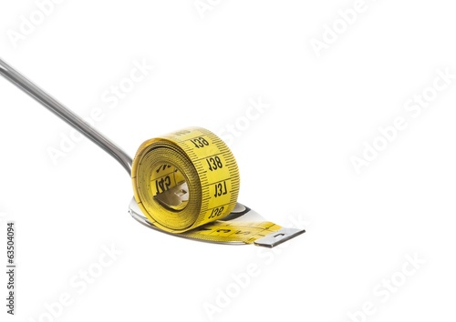 measuring tape on spoon, concept of nutrition and diet