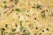 background of tagliatelle with peas and ham sauce