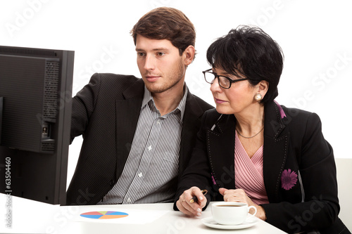 Coworkers analysing computer data