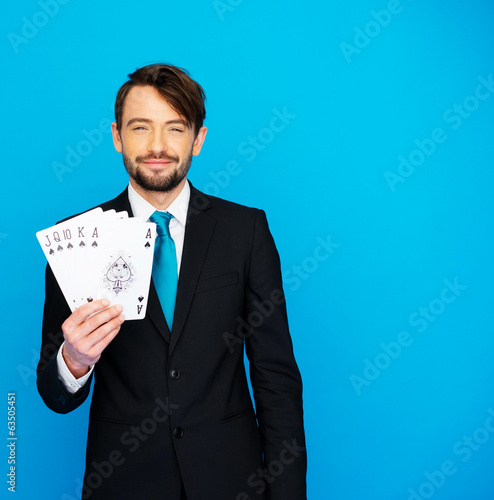 young business man showing playing cards