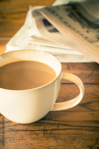 Retro style cup of morning coffee and newspaper